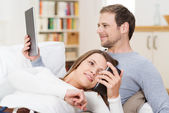 Young couple relaxing together on the sofa — Stock Photo