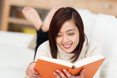 Woman studying on a sofa — Stock Photo
