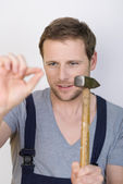 Handyman about to hammer in a nail — Stock Photo