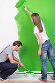 Young couple redecorating their new home — Stock Photo