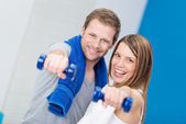 Happy couple working out together — Stock Photo