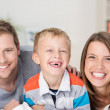 Adorable little boy with a happy parents — Stock Photo #44140221