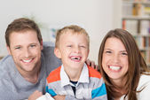 Adorable little boy with a happy parents — Stock Photo