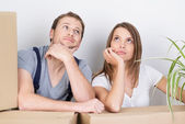 Pensive young couple considering their new home — Foto Stock