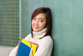 Student clutching her files — Stock Photo