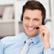 Handsome businessman using a headset — Stock Photo #45027953