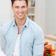 Smiling man hiding a bouquet of flowers — Stock Photo #45029941
