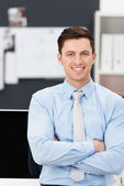 Confident sincere young businessman — Stock Photo