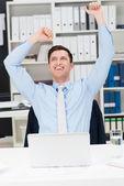 Elated businessman celebrating — Stock Photo