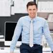 Confident smiling businessman in his office — Stock Photo