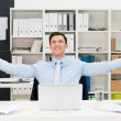 Happy businessman rejoicing in the office — Stock Photo #45031839