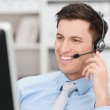 Smiling friendly male call centre operator — Stock Photo #45036347