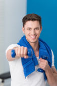 Young man working out with dumbbells — Stock Photo