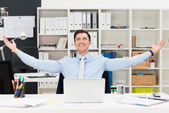 Happy businessman rejoicing in the office — Stock Photo
