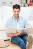Young man working at home in the living room — Stock Photo