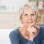 Wistful senior woman sitting thinking — Stock Photo #45288913