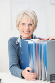Happy contented senior businesswoman — Stock Photo