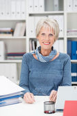Senior manageress sitting in her office — Foto de Stock