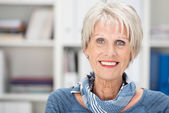 Happy senior woman with beautiful blue eyes — Stock Photo