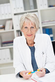 Observant senior businesswoman — Stock Photo