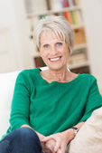 Confident relaxed beautiful senior woman — Stock Photo