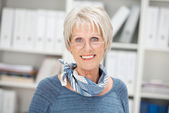 Smiling senior businesswoman wearing glasses — Stock Photo