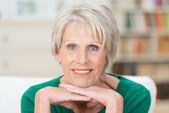Thoughtful pensioner looking at the camera — Stock Photo