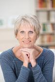 Attractive elderly blue-eyed woman — Stock Photo