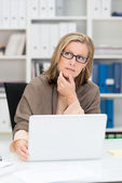 Pensive middle-aged businesswoman — Stock Photo