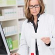 Middle-aged female pharmacist at work — Stock Photo #46212495
