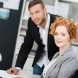 Attractive businesswoman with a male colleague — Stock Photo