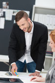 Businessman chatting with a female co-worker — Stock Photo