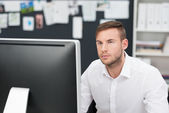 Handsome young businessman concentrating — Stock Photo