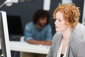 Beautiful engrossed young businesswoman — Stock Photo