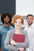 Successful female job applicant clasping her CV — Stock Photo