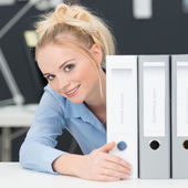 Hardworking young businesswoman — Stock Photo
