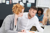 Two concerned young business people — Stock Photo