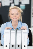 Beautiful businesswoman with a heady workload — Stock Photo