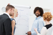 Business team discussing analytical graphs — Stock Photo