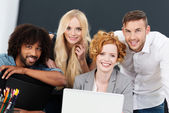 Smiling successful young multiracial business team — Stock Photo