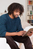 Young African American man using a tablet — Stock Photo