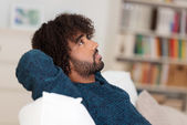 Young African American man sitting thinking — Stock Photo