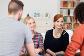 Two young woman chatting to their boyfriends — Stock Photo