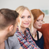 Beautiful young blond woman with her friends — Stock Photo