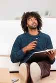 Young African American man working at home — Stock Photo