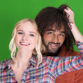 Laughing happy multiracial couple — Stockfoto