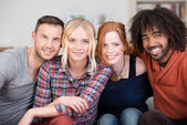 Four happy multiracial friends — Stock Photo