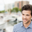 Handsome man visiting boat harbour — Stock Photo #48790317