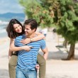 Man giving his wife a piggy back ride — Stock Photo #48790715
