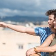 Man pointing out over sandy beach — Stock Photo #48790893